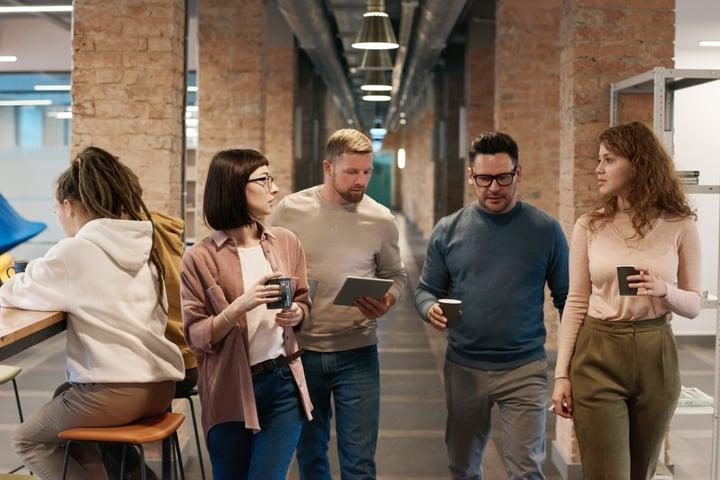photo-of-people-walking-on-hallway-3182787